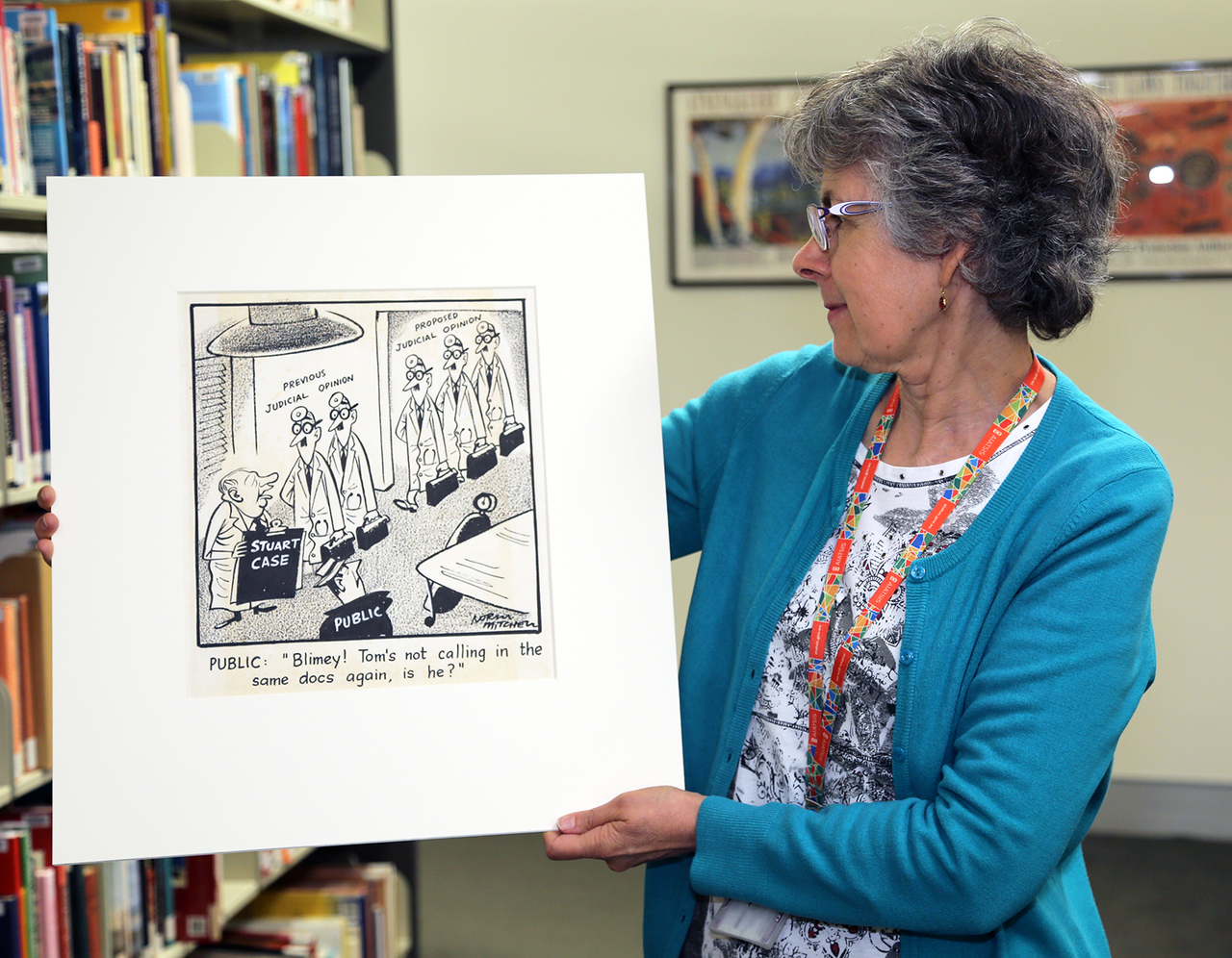 A woman holding a cartoon drawing