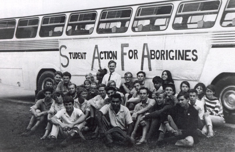 SAFA students sitting beside the Freedom Bus