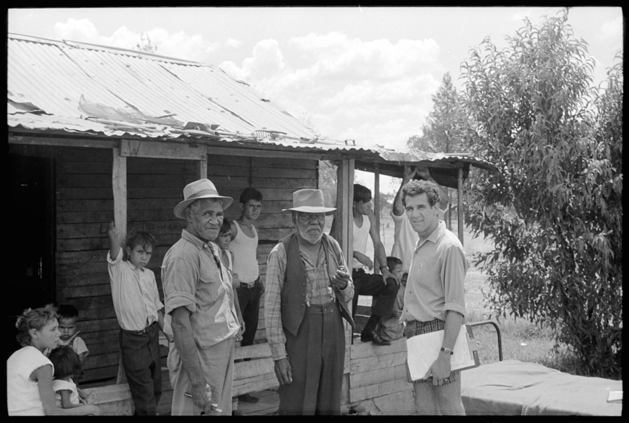 Charles Perkins with people on the mission at Moree